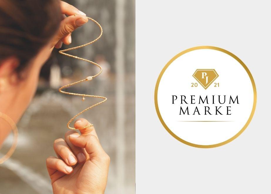 """Sie sehen: das weltweit erste massive Goldarmband ohne Verschluss, das mit einer Hand an- und abgezogen werden kann und dann wieder in seine ursprüngliche Form """"zurückfedert"""". Der Name ist Programm: Wellendorffs neueste Innovation heißt """"federndes Gold""""."""